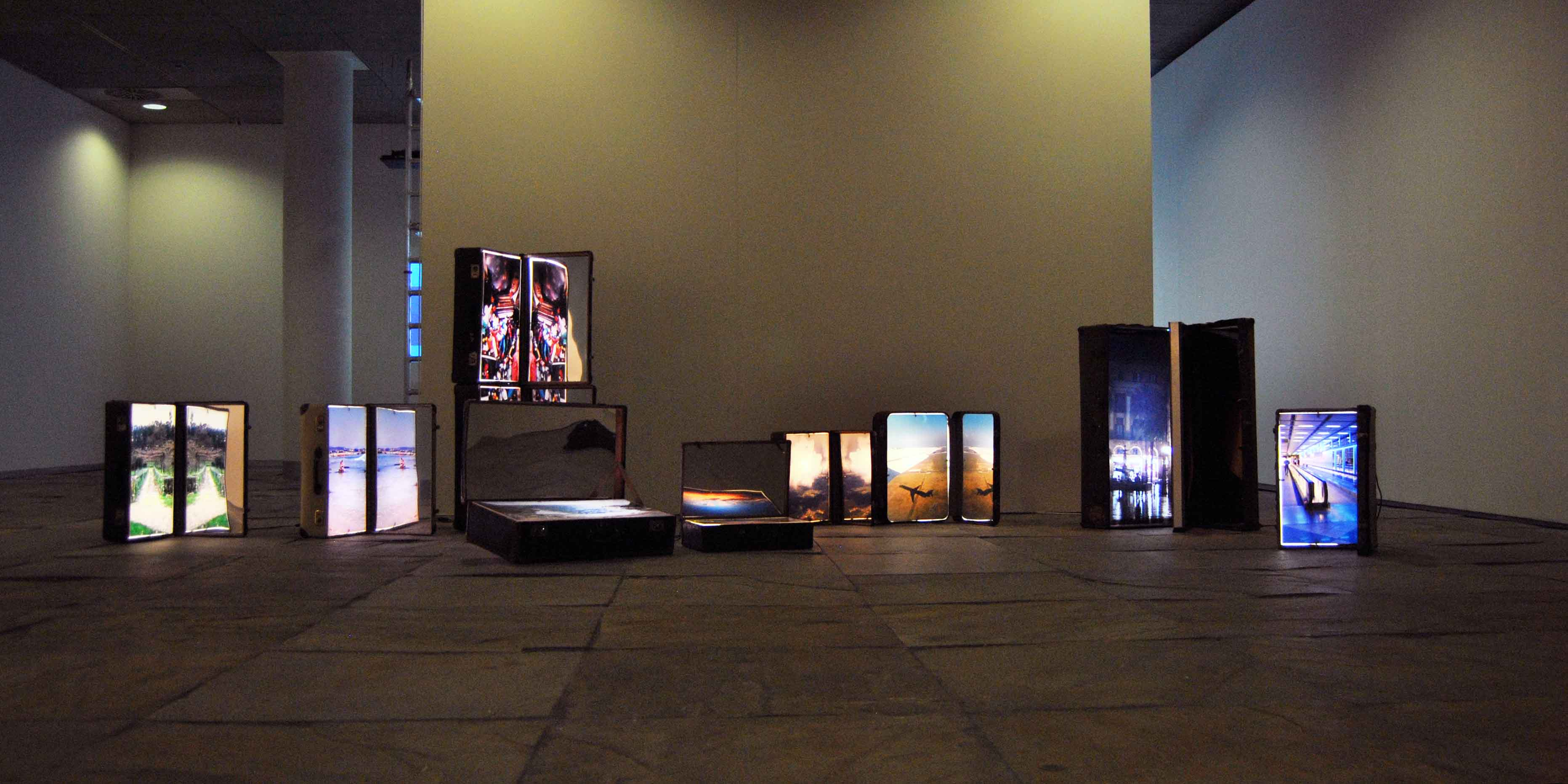 Installation of Chema Alvargonzalez's suitcases in Tránsito Solo exhibition, 2014.